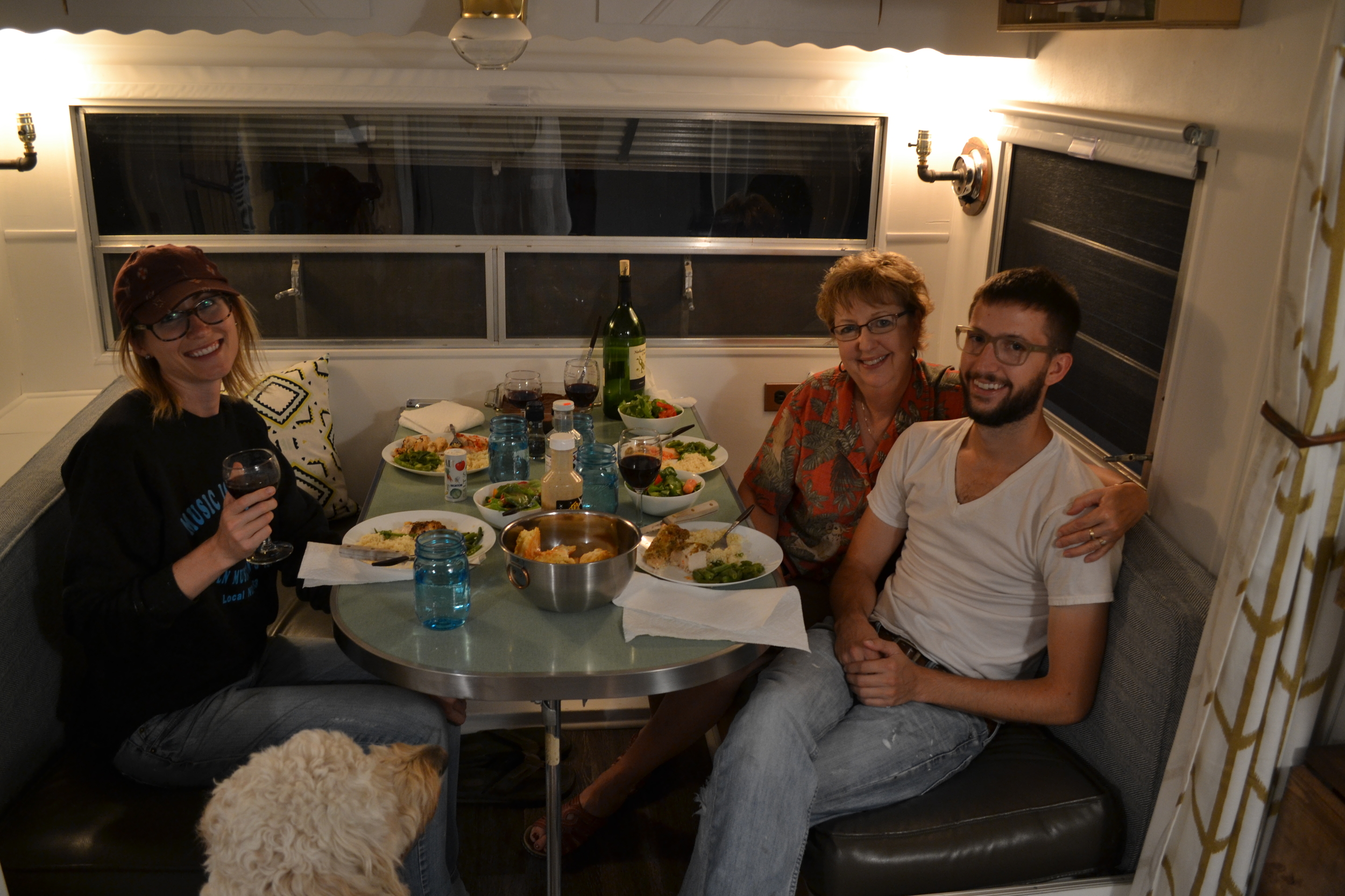 A shot of our first meal in Elsie! Baked chicken, cheese biscuits, salad and a bottle of wine. From L to R: Mel, Mary Vaughan, Carson. Not pictured: Jerry Vaughan (he's taking the photo!).