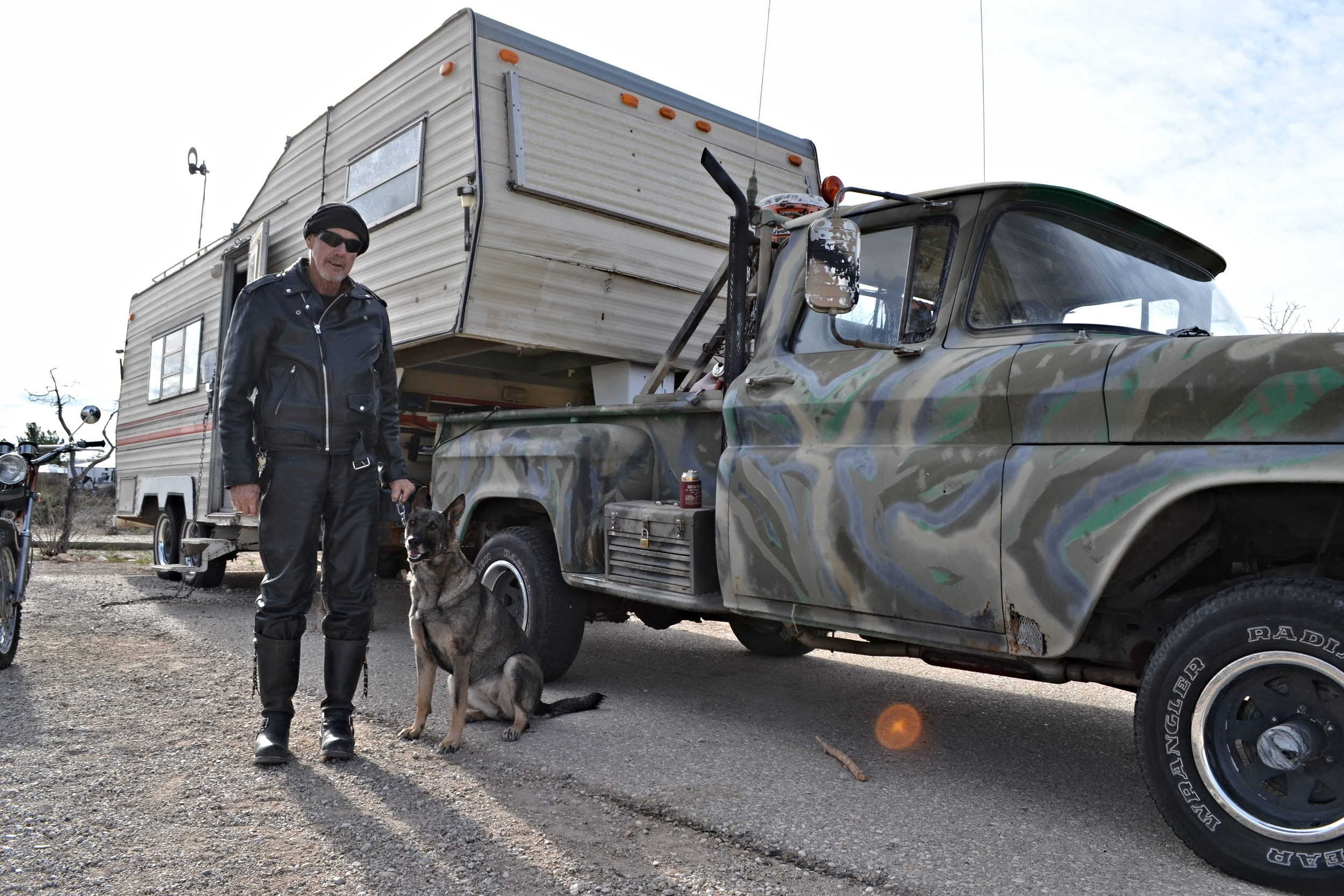 Richard Shuman and his service dog, Hannah, pose before their outpost at Brantley Lake State Park, New Mexico.