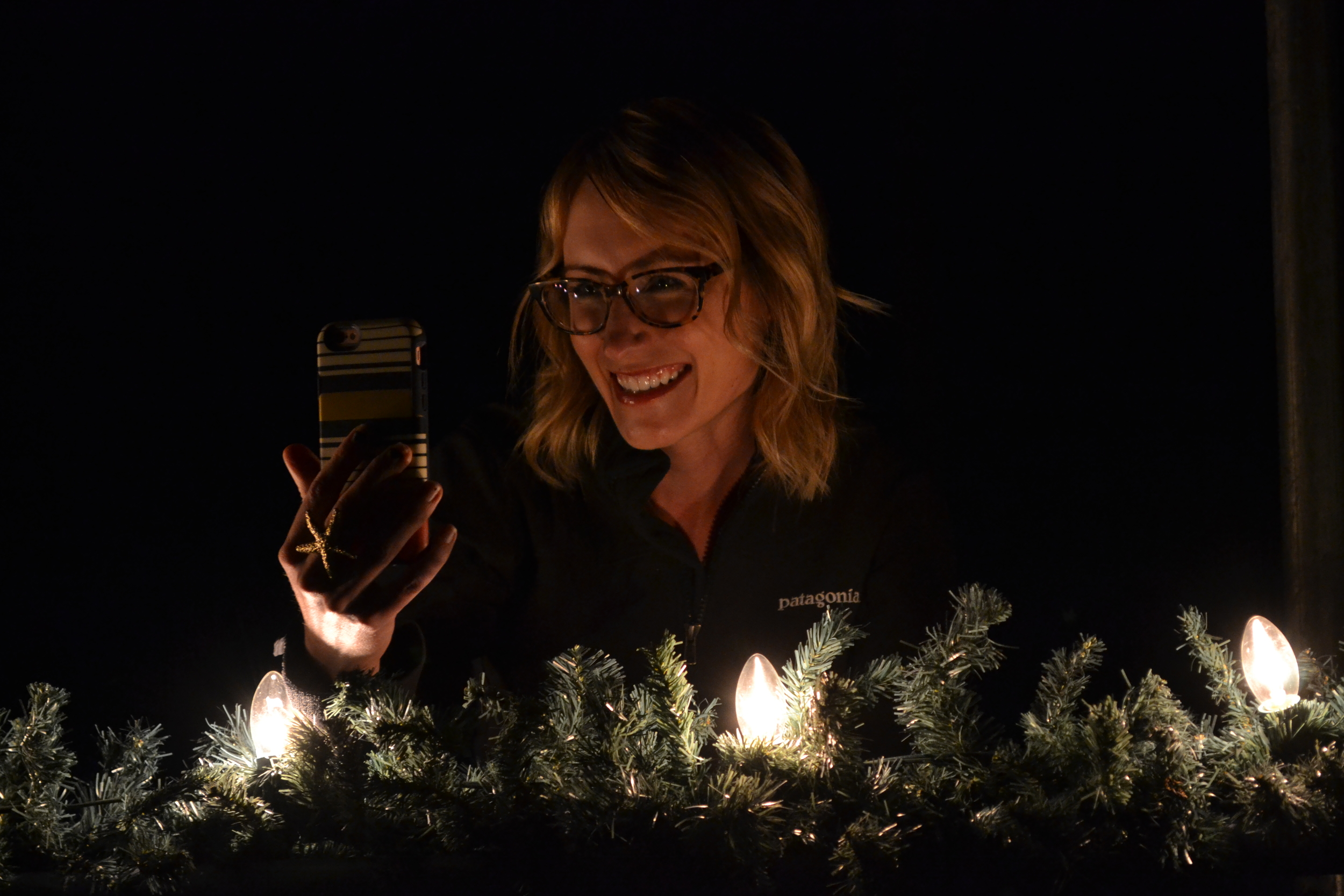 Mel FaceTimes with her family directly after the Christmas Eve Service. Here she is near the lights outside the Fort Davis Courthouse.