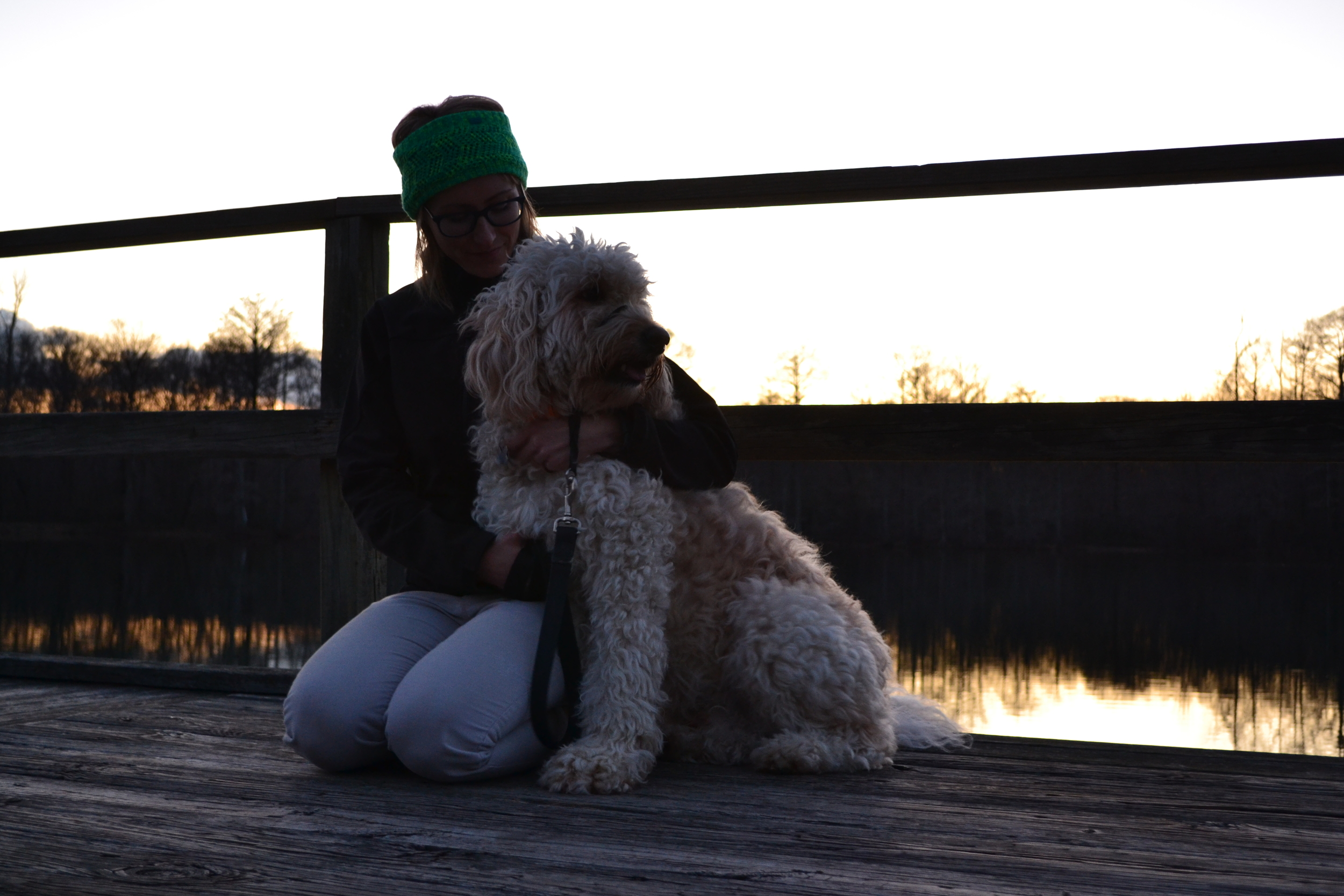 Mel and Costello enjoy a sunset on the dock at Wall Doxey State Park.