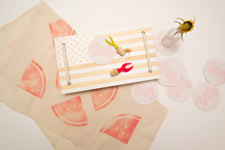 Tabled's Picnic in the U.S.A. collection. Includes one extra large watermelon print table square, a set of 10 Awesome coasters, a yellow or hot pink eagle bottle stopper (made from an old trophy!), and a handmade U.S.A. flag serving board.