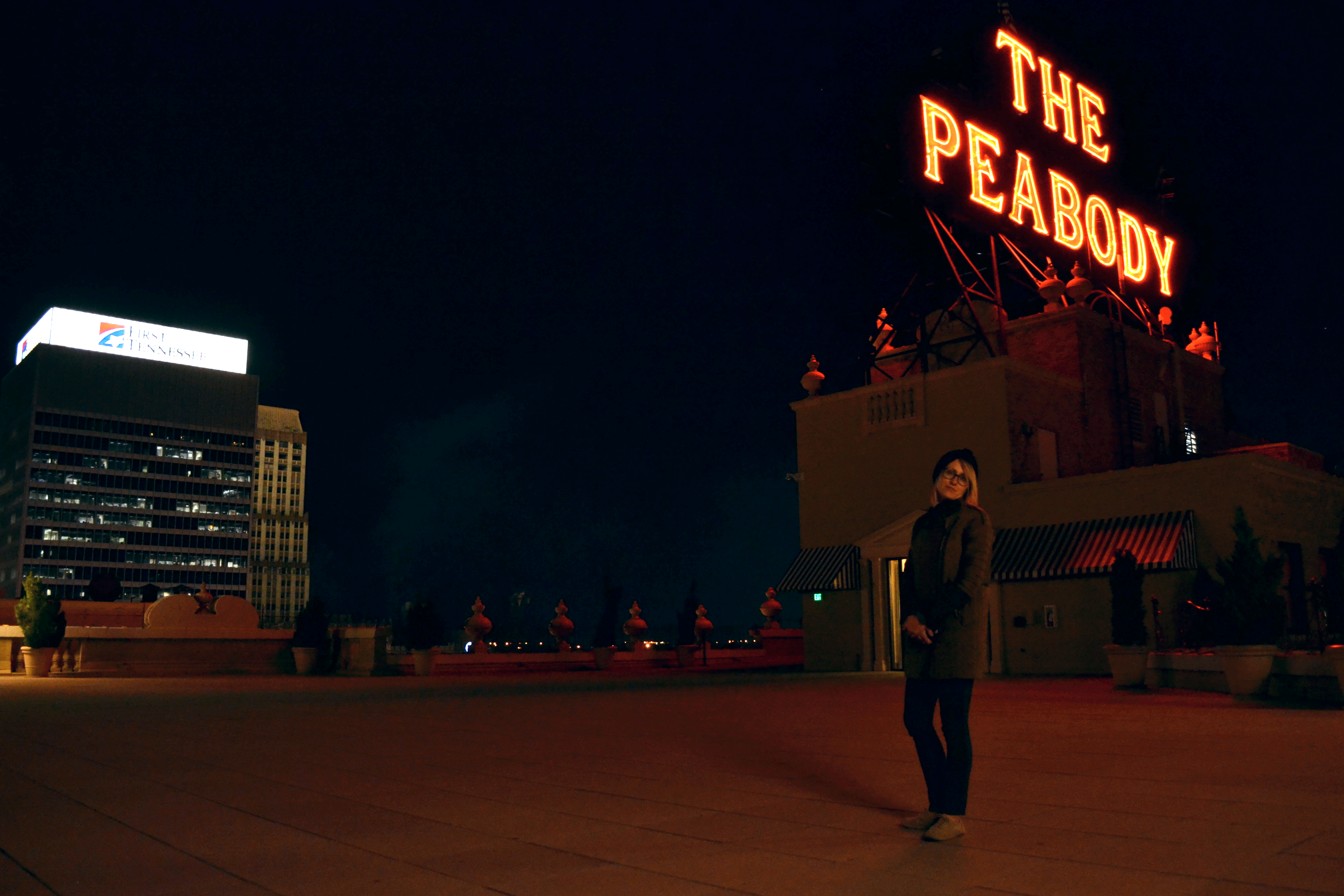 Mel basks in the neon glow of the Peabody Hotel rooftop.