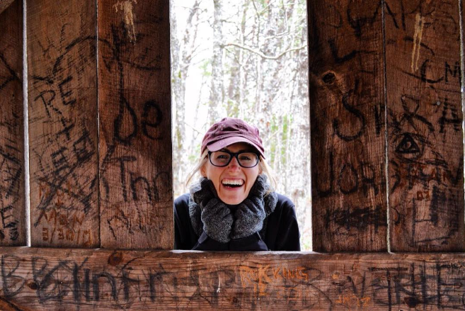 Mel takes a peek through an old cabin on the trails at Fall Creek Falls.