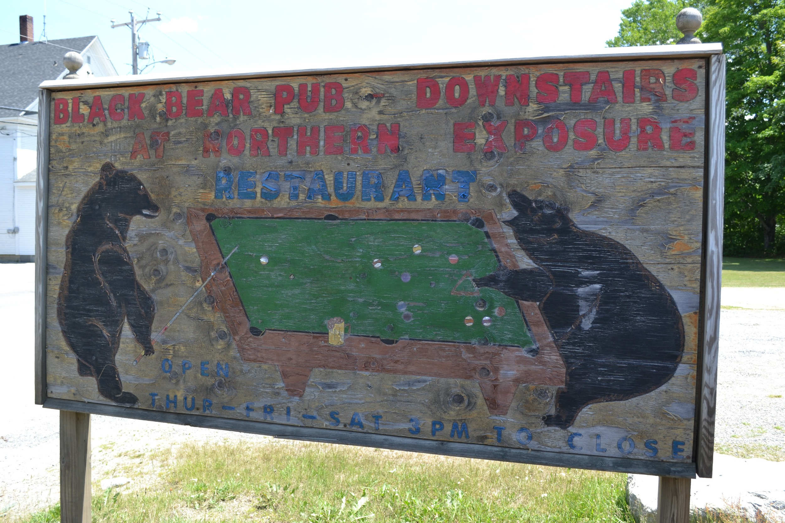 The cool old sign for Northern Exposure restaurant and Black Bear Pub in Errol, NH.