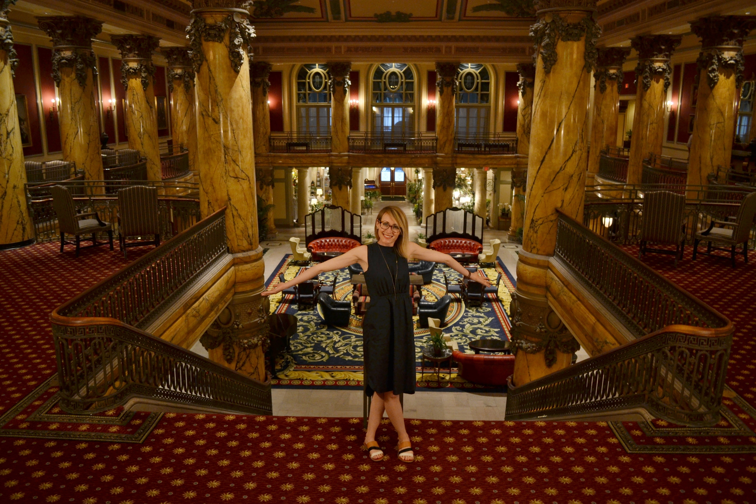 Mel is happy to show off the grand staircase at The Jefferson.