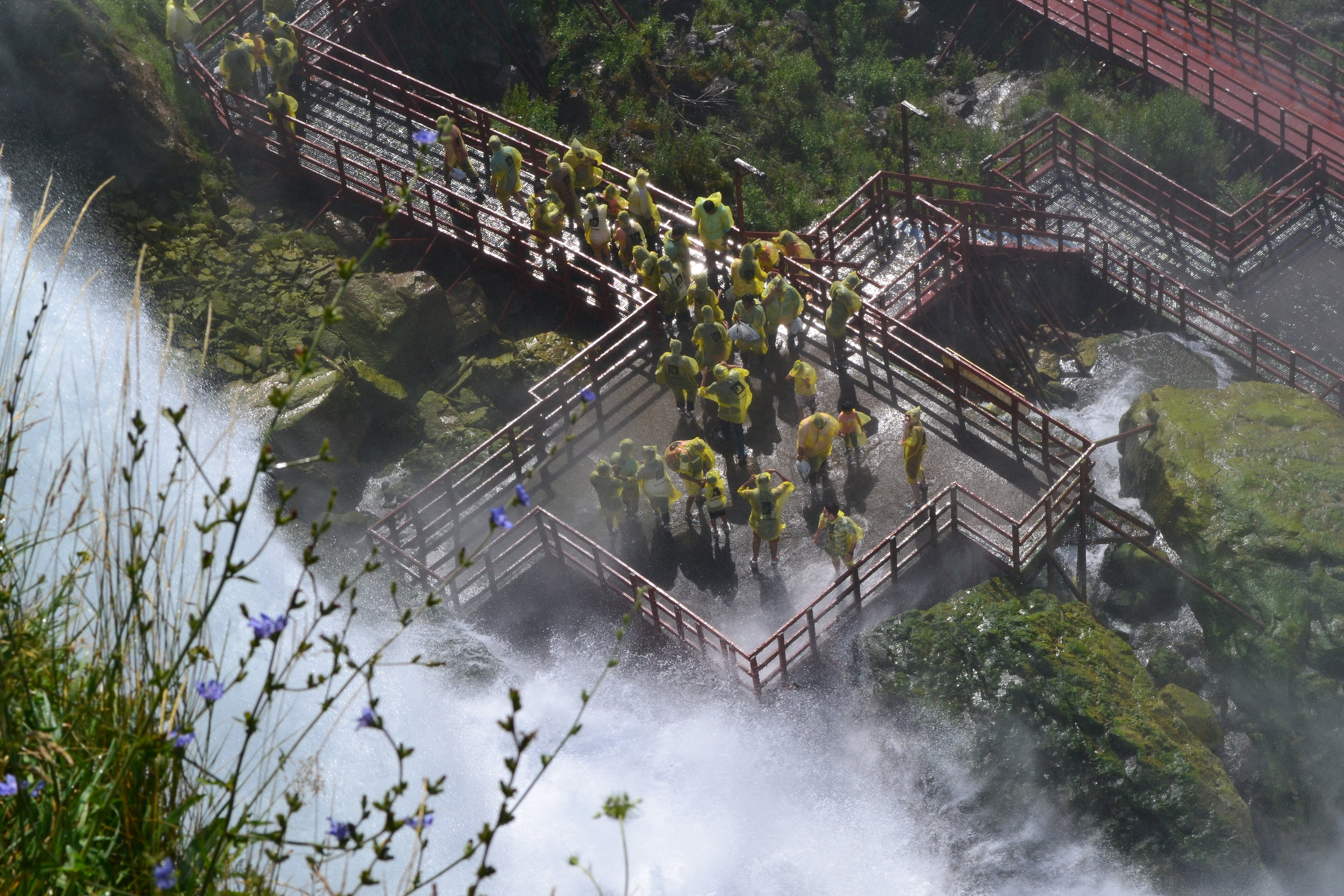 """Some tourists explore """"under the falls"""" at Niagara."""