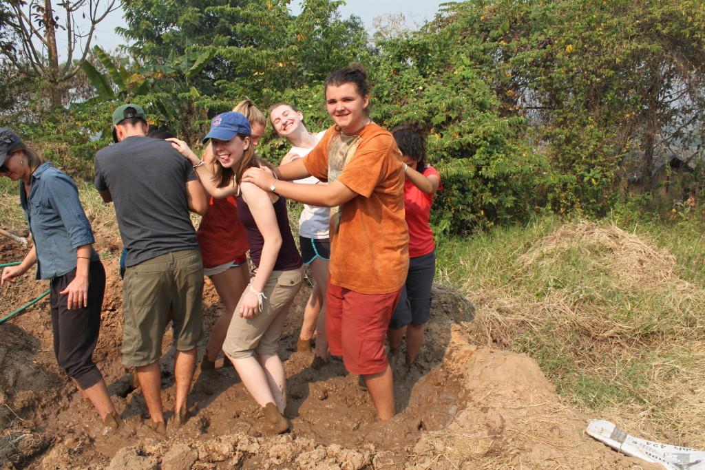 Some of the Sabai group making mud (adobe) blocks