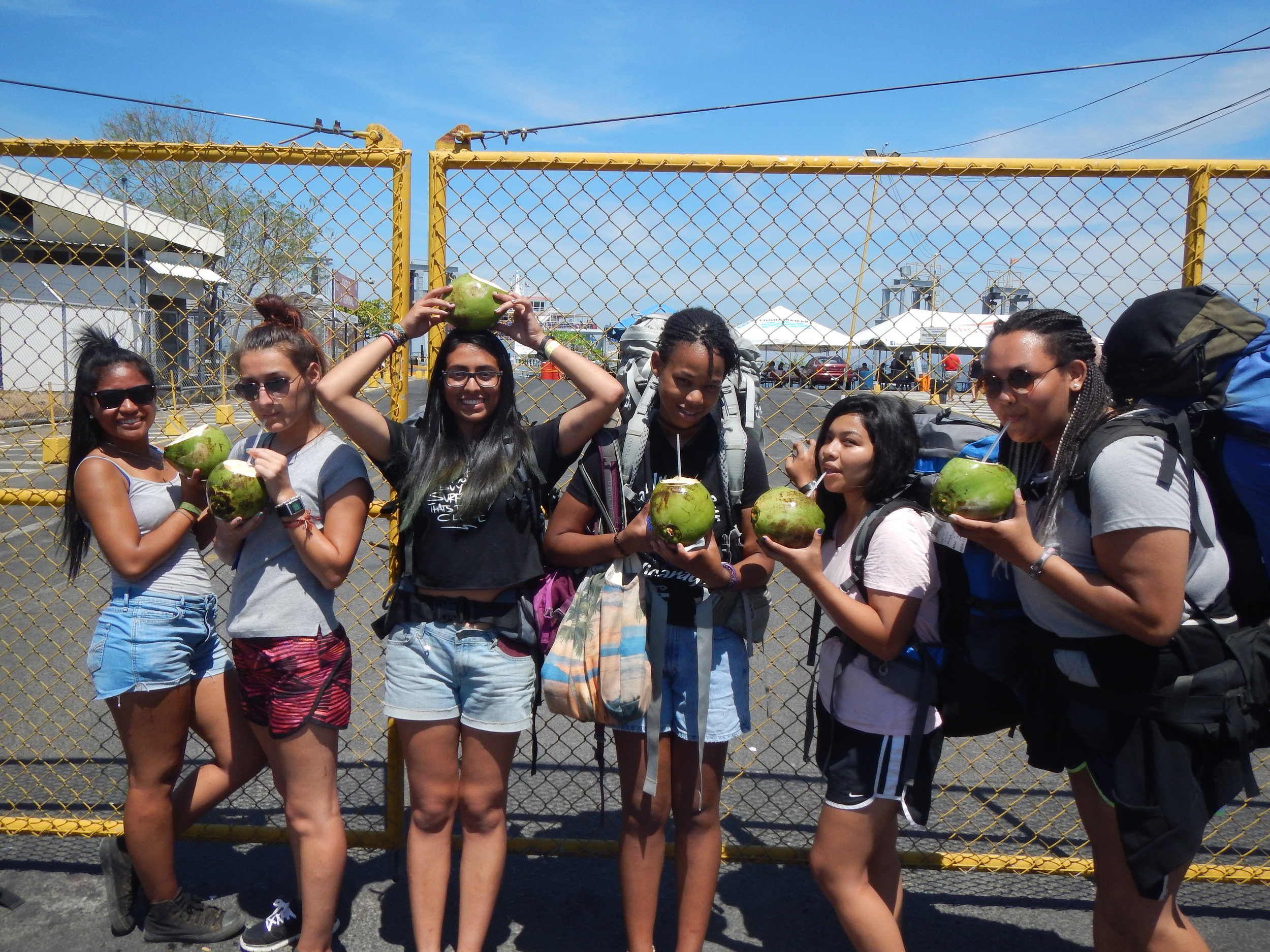 The chicas drinking pipa (cold coconuts) waiting for the ferry