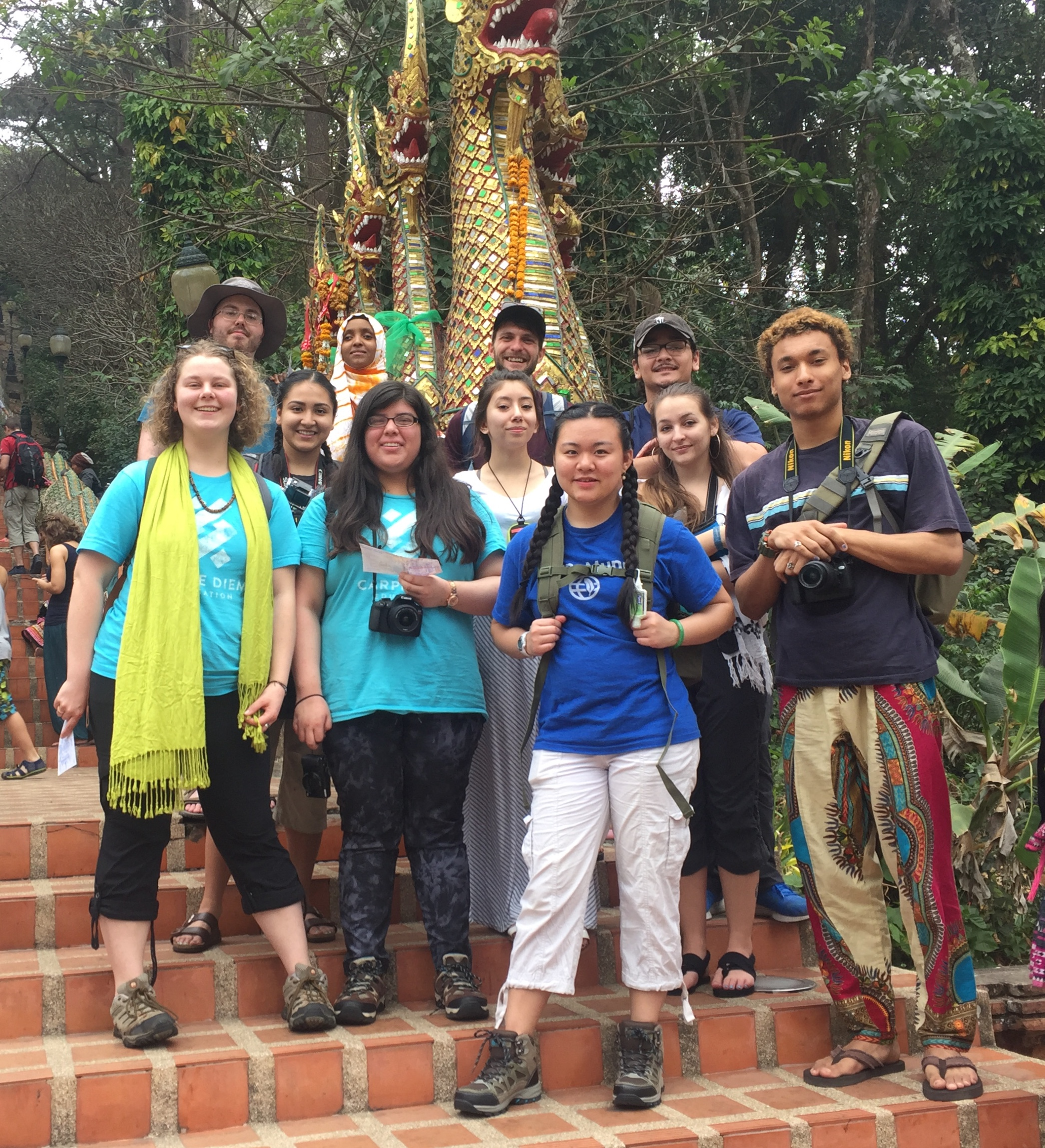The Hathai group poses under the nagas that guard the entrance to the the mountain-top temple of Wat Doi Suthep