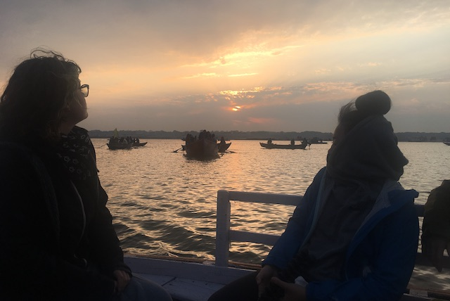 Olivia and Kari catching a sunrise on a boat in Varanasi.