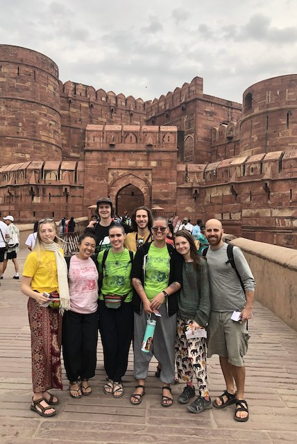 The whole group (at the Red Fort) just before the rain.