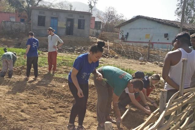 Shanti-Spring-2019-44 Kari and Olivia planting 2.jpg