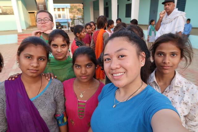 Kari, Rishi-Ji (in the back) and Olivia taking selfies with the girls.