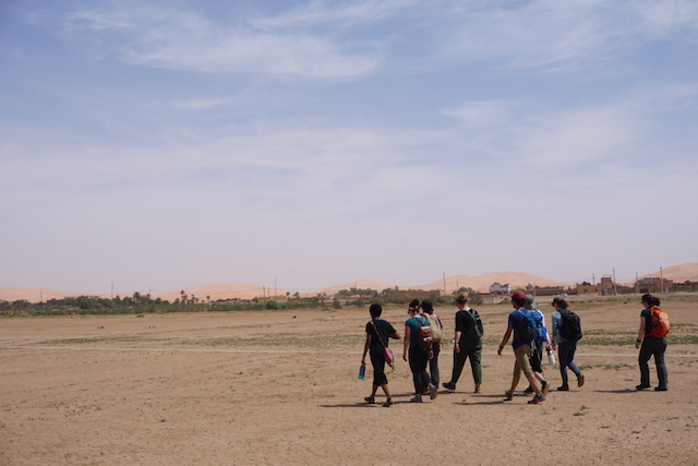 Walking to Merzouga, the desert town we stayed in.