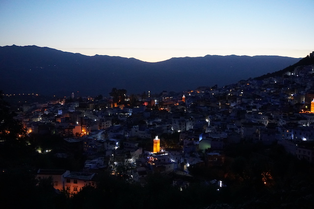 The view of the sun set on Chefchauen from the Spanish Mosque. Other mosques are well lit throughout the city.