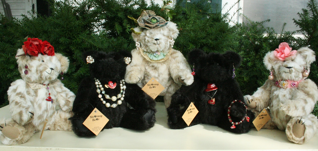We took a late mother's two great old synthetic fur jakets to make these bears for her kids. The coustume jewerly belonged to her as well. 2016. 3 pictures.