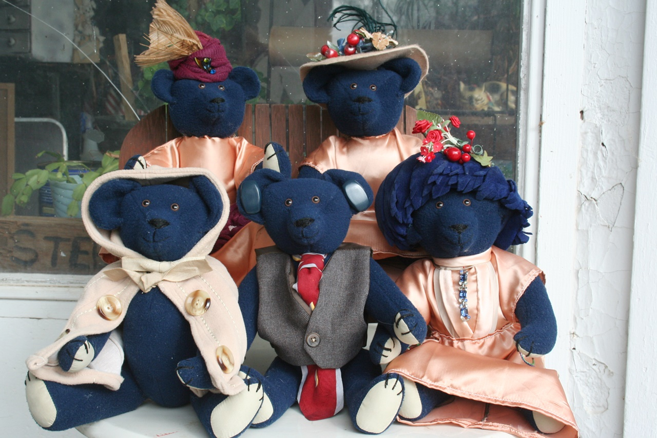 "We made these five 12"" Stearnsy Bears from a great vintage blue wool coat. Then Vicky incorporated the lining and buttons as well as other pieces in thier outfits. 2011. 4 pictures."