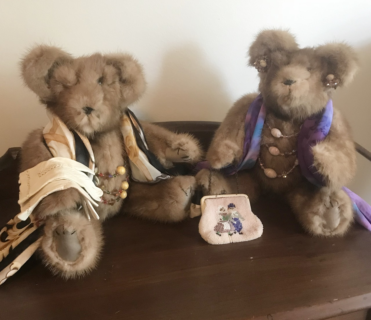 For Connie, 2018, 3 pictures. We made thers bears from Connie's vinatge mink stole. Then she dressed them herself them in these wonderful old family pieces.