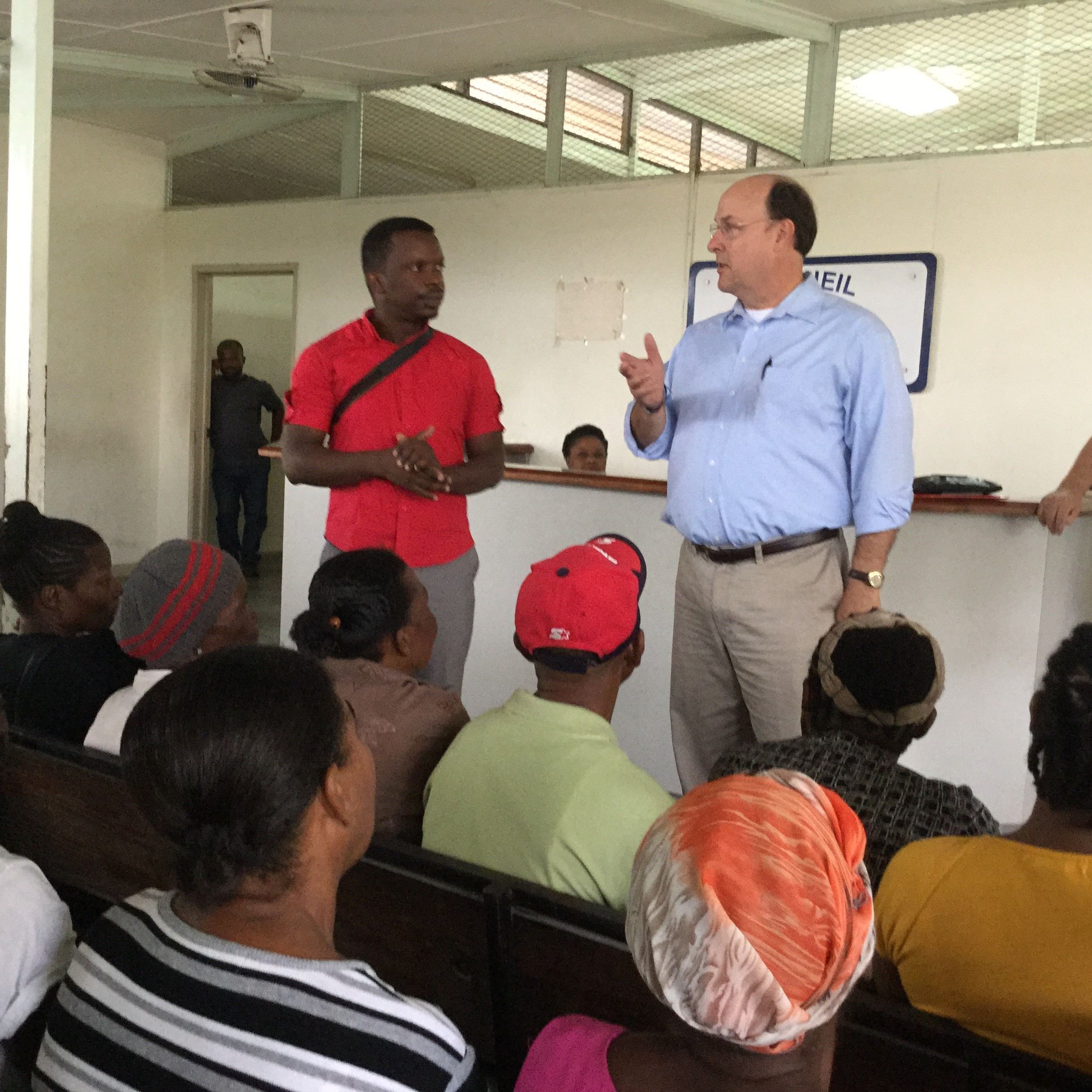 Dr. Tommy Brumett, with the help of a translator, shared God's word with people gathered to receive medical services at Grace Children's Hospital. The hospital serves 180,000 people every year and leads the fight against tuberculous and HIV in Port-au-Prince and 149 surrounding communities.