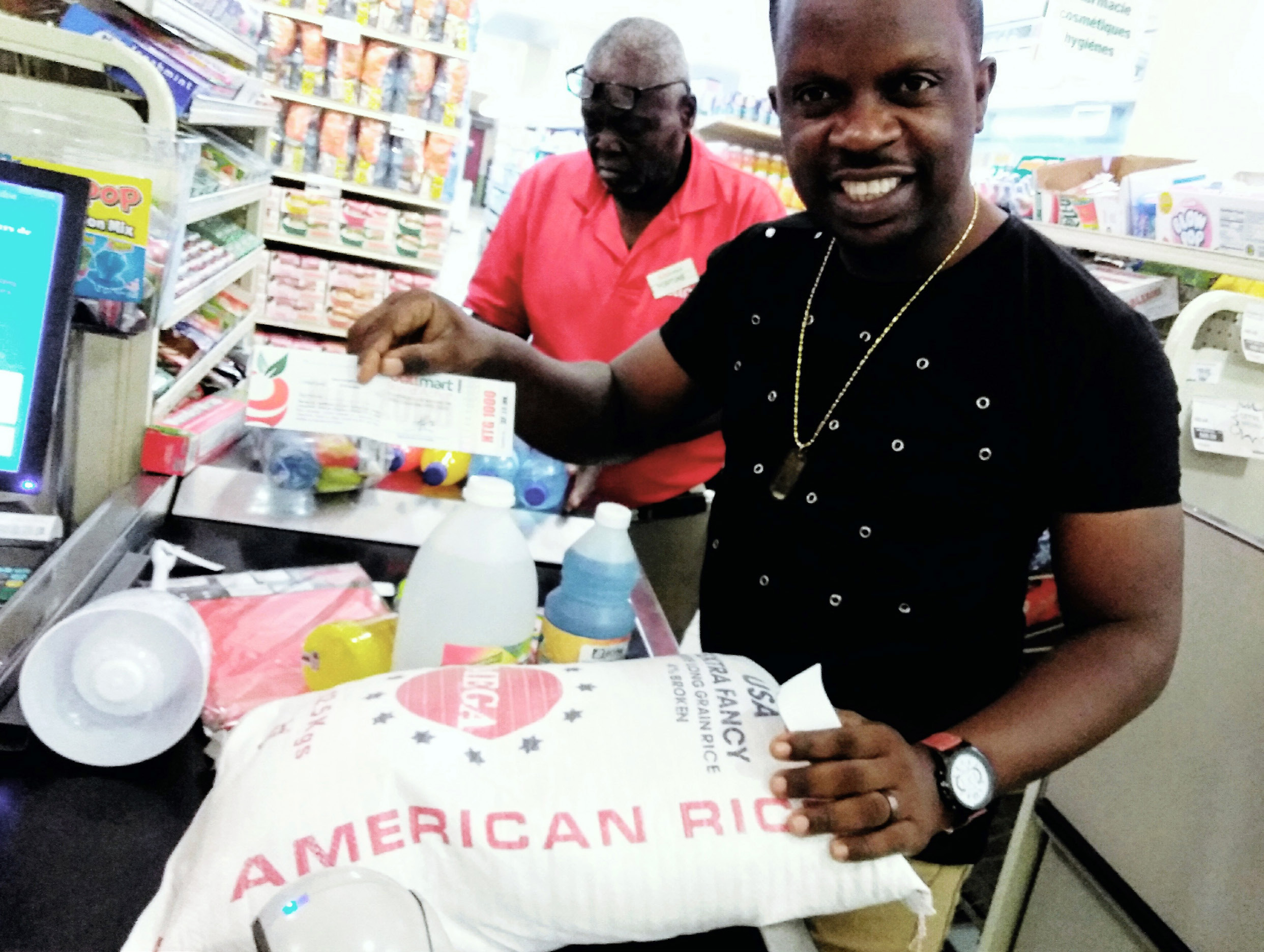 GCH Public Relations Coordinator Robenson Lucceus using food stamps to purchase rice at a local grocer. Food prices are up more than 20% over 2018.