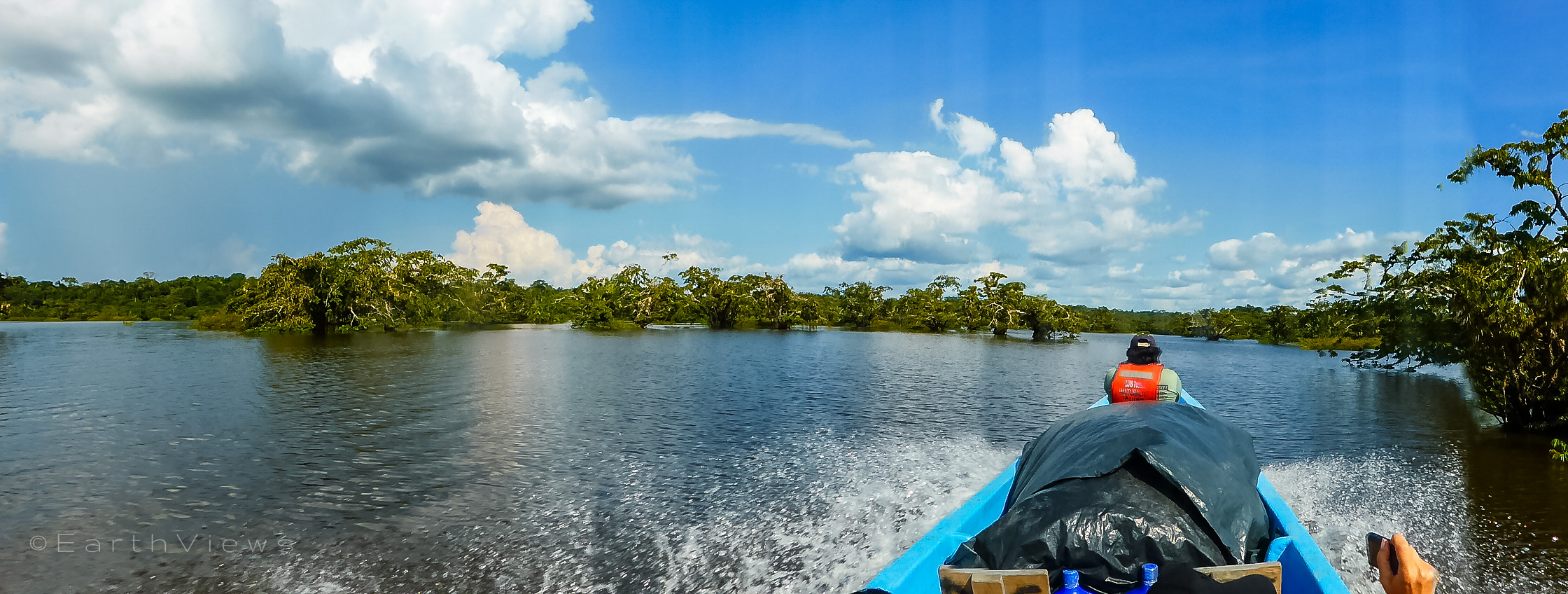 Our naturalist guide, Luis Torres, spotting wildlife in the boat's front.