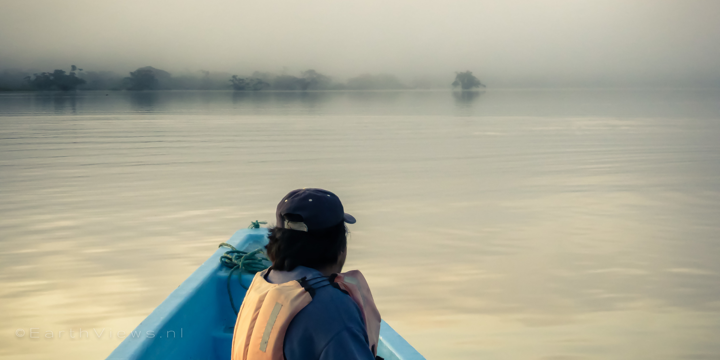 Luis searching for pink dolphins on our early morning boat trip.