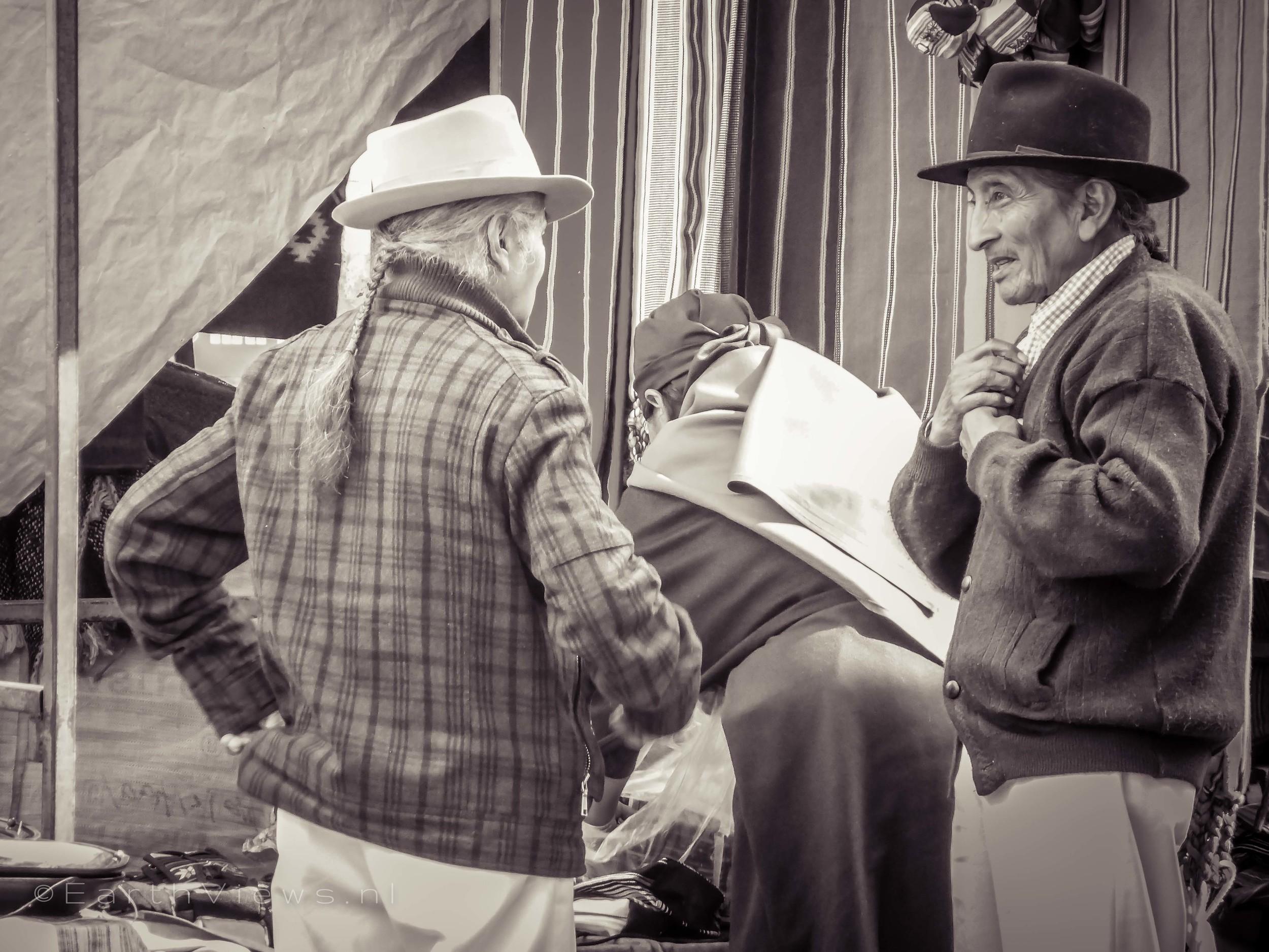 Otavaleños in traditional style on the Otavalo market.
