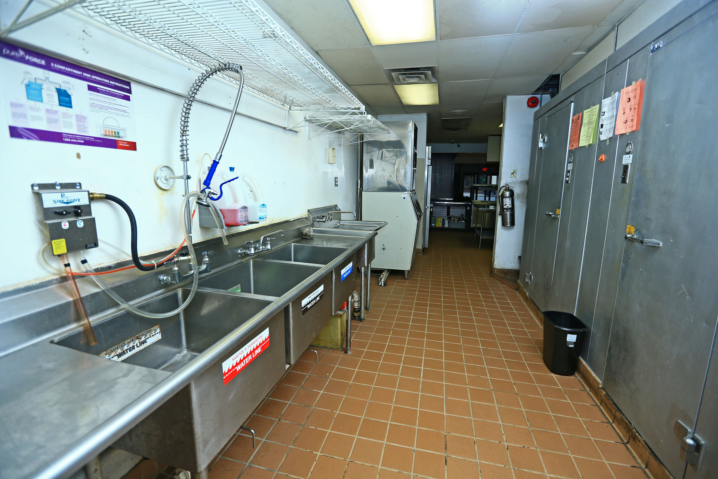 Kitchen sinks and refrigerator and freezer.jpg