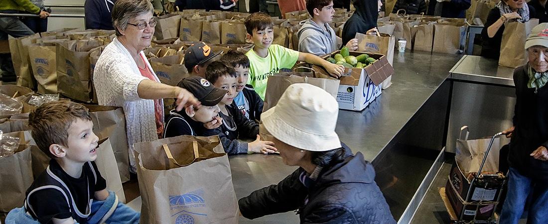 Volunteers serving food at the WBT food pantry.