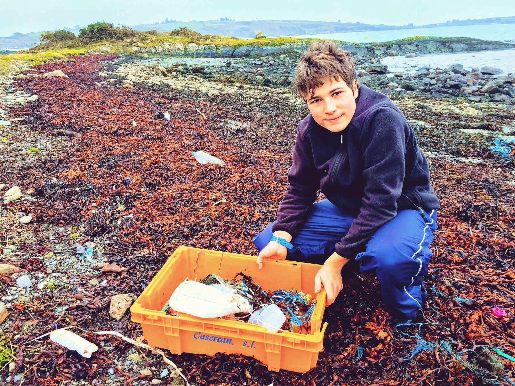 Fionn Ferreira collecting plastic waste