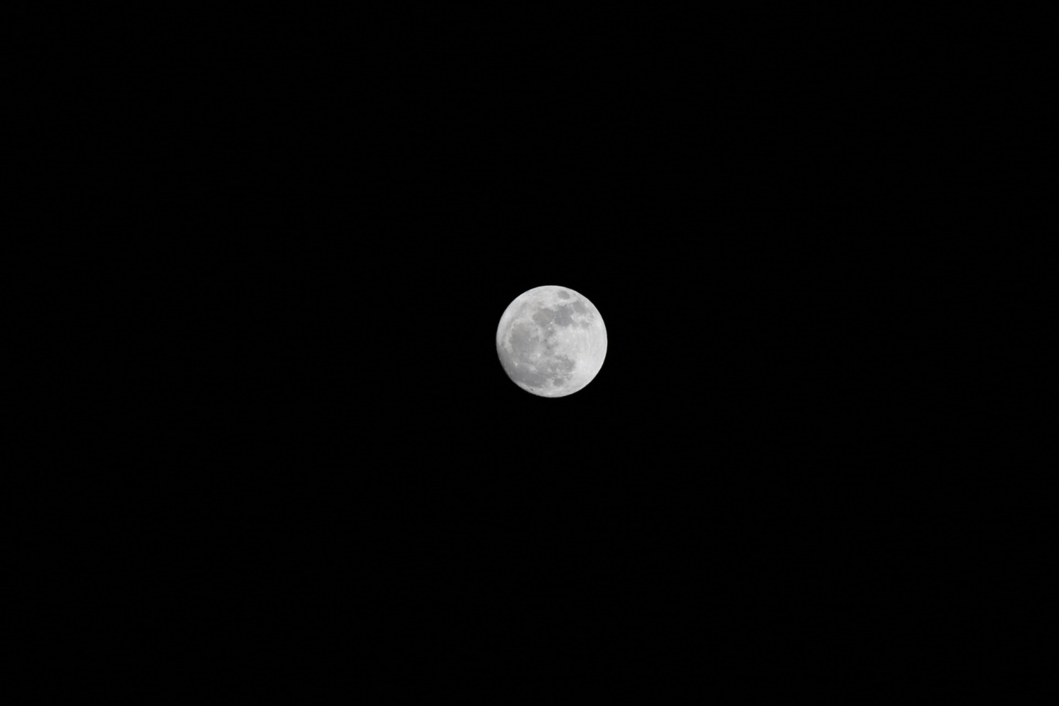 Moon photo uncropped -even with a big lens, it still looks small!