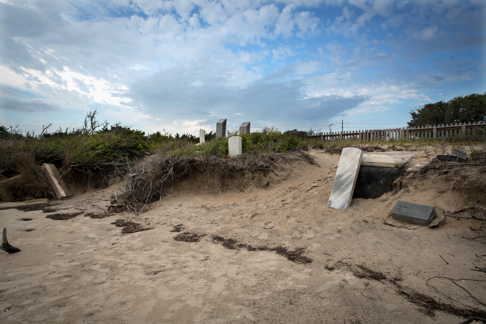 A private graveyard is slowly claimed by erosion and high waters in the Salvo Day Use Area on Cape Hatteras National Seashore. It is surrounded on three sides by national park land and Pamlico Sound on the other. The North Carolina gravesite existed long before the area became a park in 1965.
