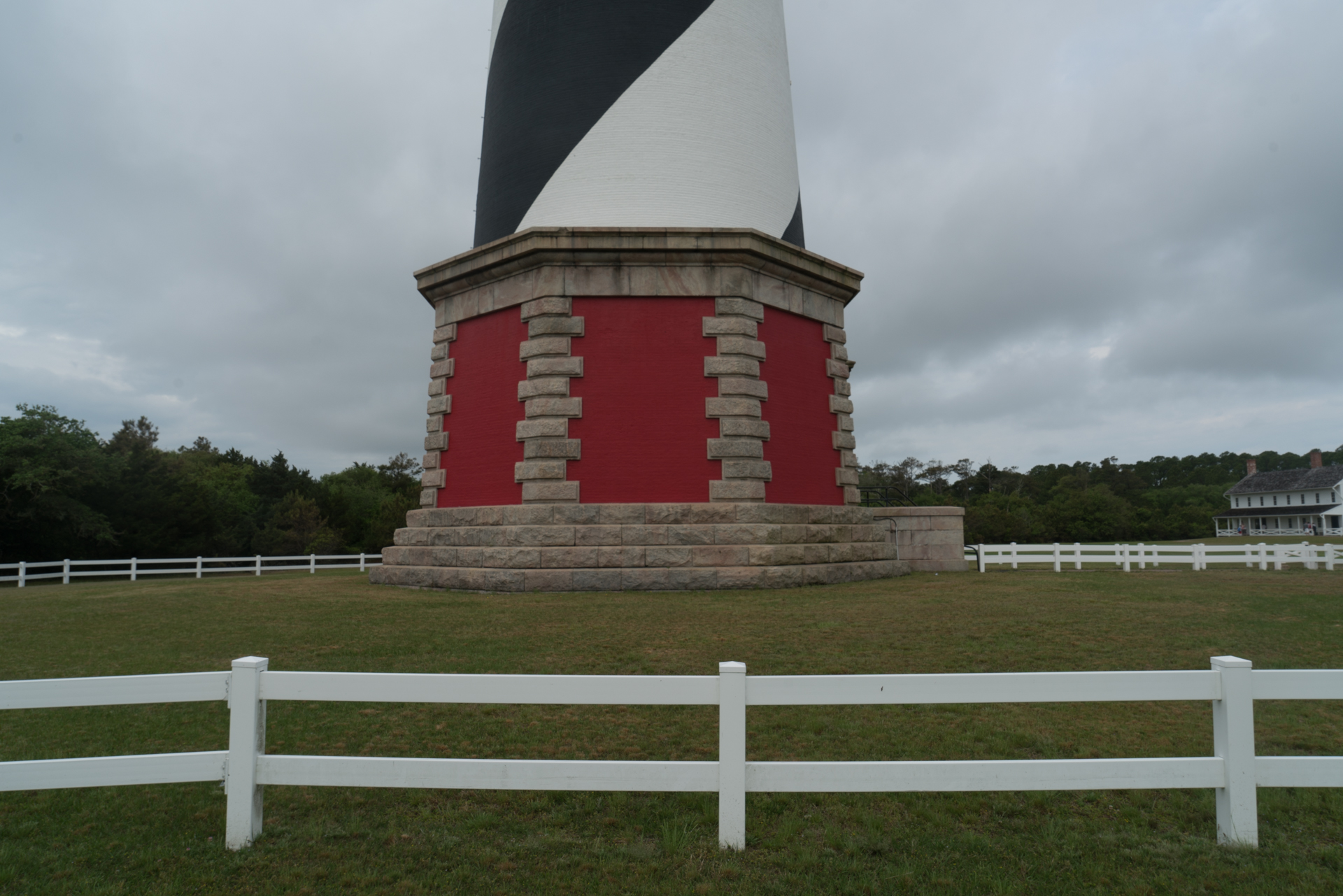 """Hatteras Lighthouse,was moved nearly half a mile inland to higher ground in 1999 after years of """"beach nourishment,"""" a practice that replaced lost beach sand. The dynamics of a barrier island keep it in constant motion. The neighborhood being swamped by sand dunes is just a few hundred feet from the original site of the lighthouse."""