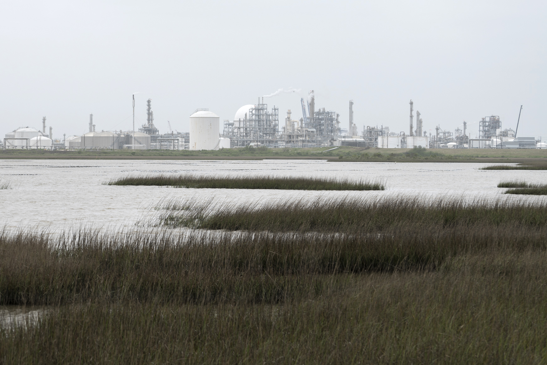 Dow Chemical plant and salt water marshes, Freeport, Texas.