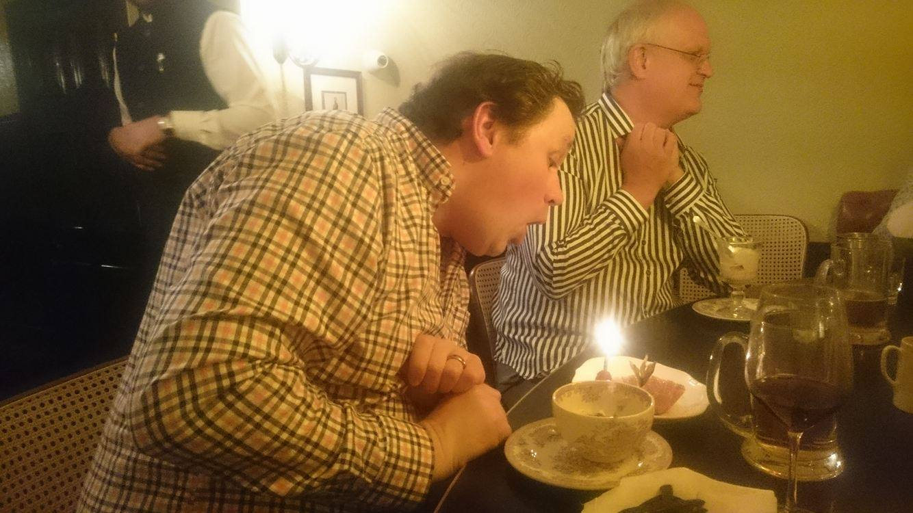 Russ blowing out his candle on his team cake