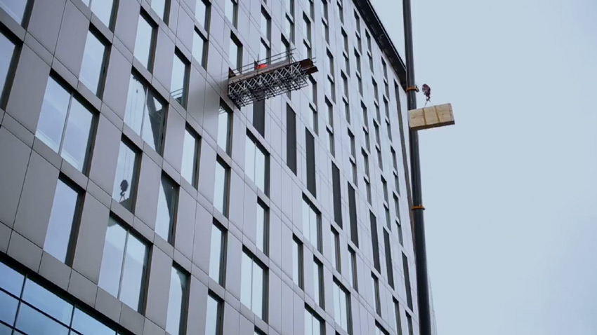 crane to deliver studio materials to the 7th floor