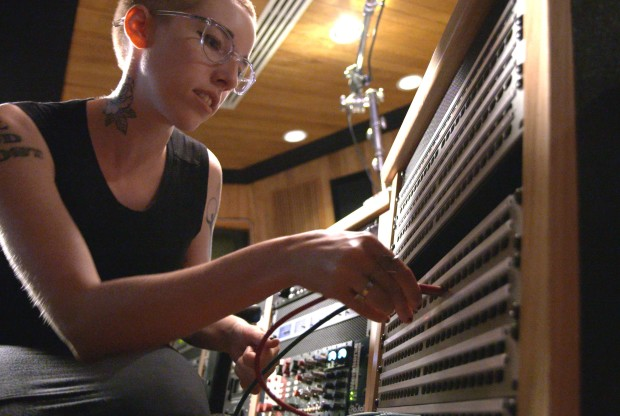 Women's Audio Mission girl using patchbay