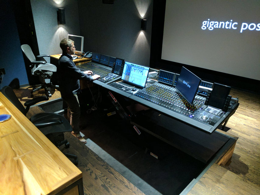 Gigantic Post Avid S6 dual Operator console showing mixers working standing up