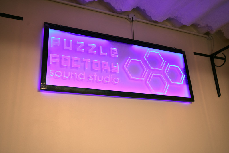 Puzzle Factory Glowing Sign.