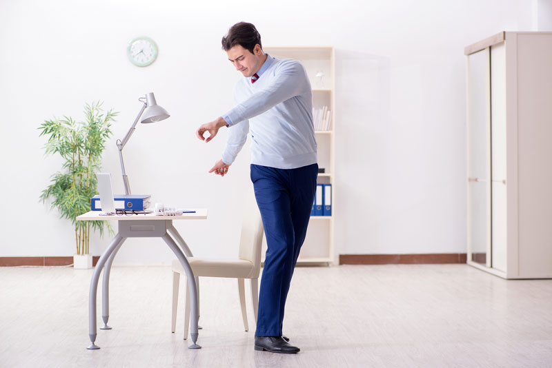 doing-stretching-exercises-at-the-desk-2.jpg