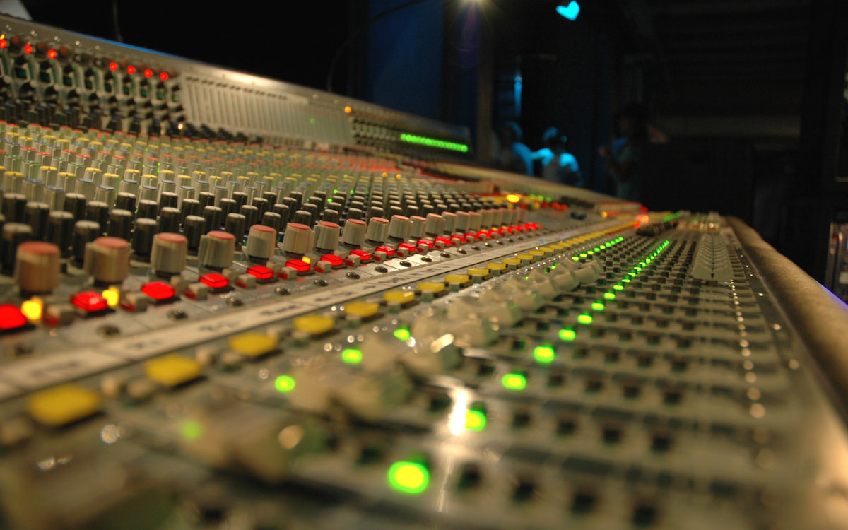 a picture of a mixing desk in a recording studio