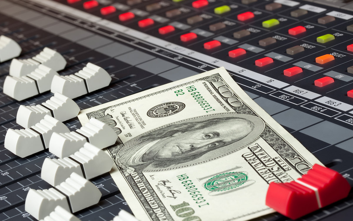 a picture of a hundred dollar bill on a mixing desk