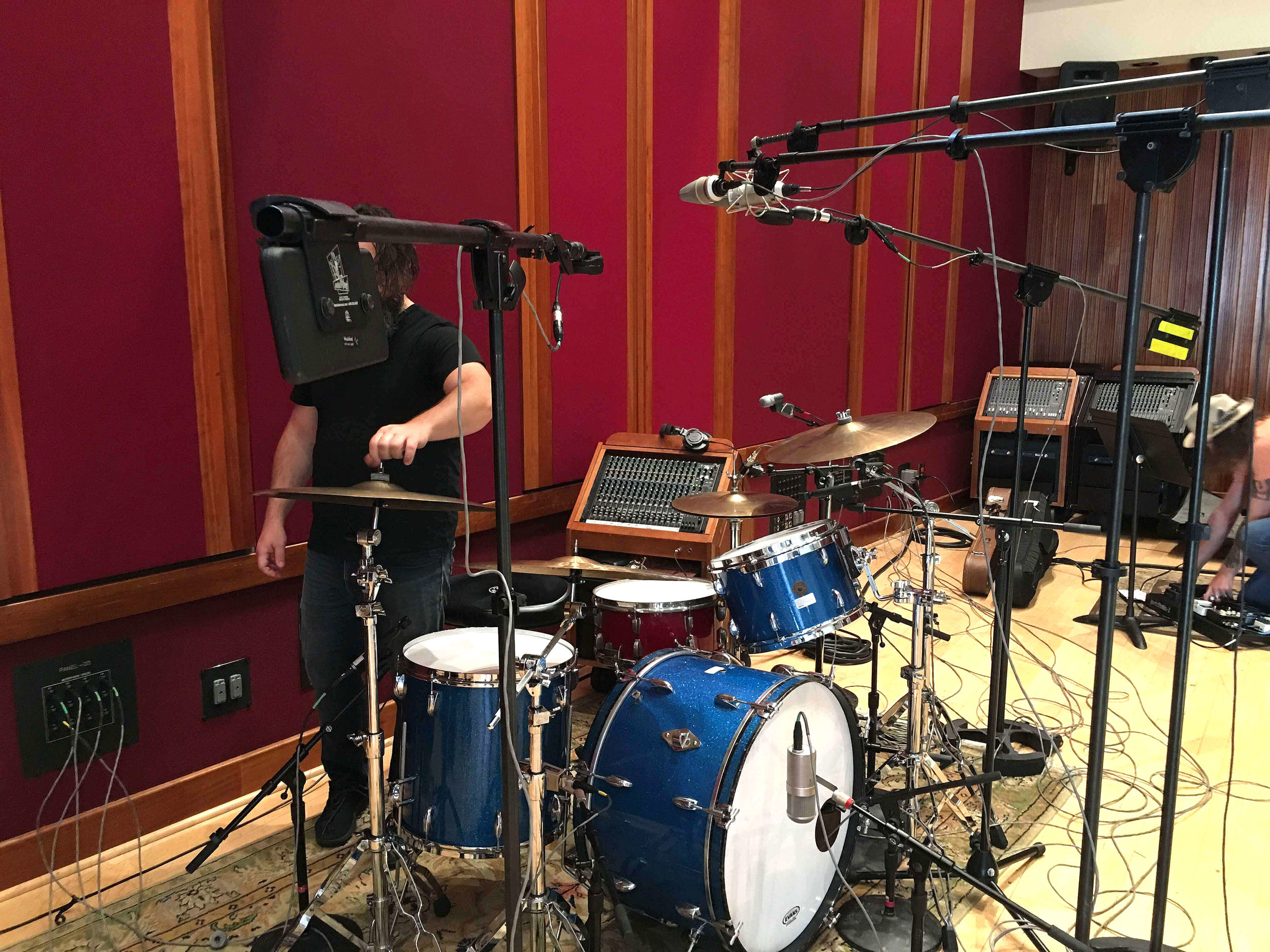 The kit was placed mid-room in Studio A at Blackbird. Drums sound excellent in this room no matter where you place them which is not the case in some large studios. In this case, it worked best for line of site to the other players.