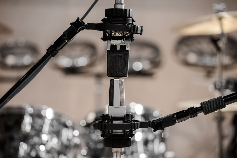 A Pair Of AKG C414 Mics Set Up In A Mid/Side (M/S) Pair In Front Of A Drum Kit.