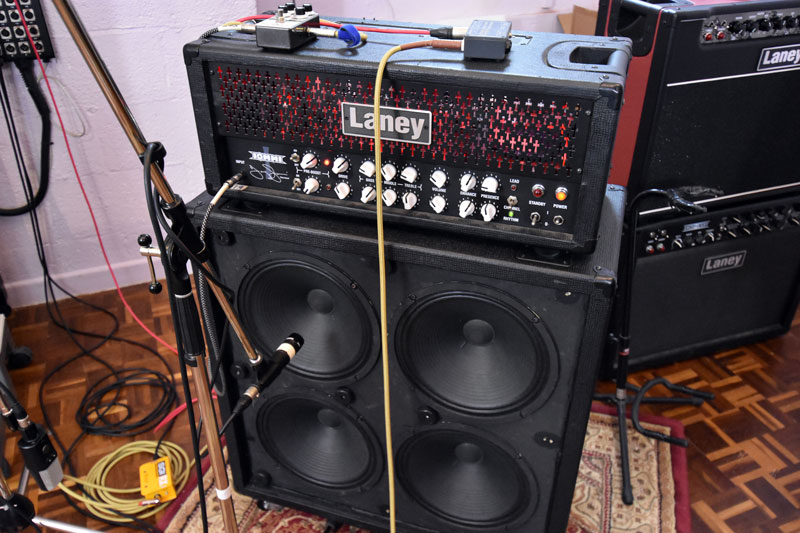 You can see the Shure SM 57 pointing directly at the centre of the top left speaker in this 4x12 cab.