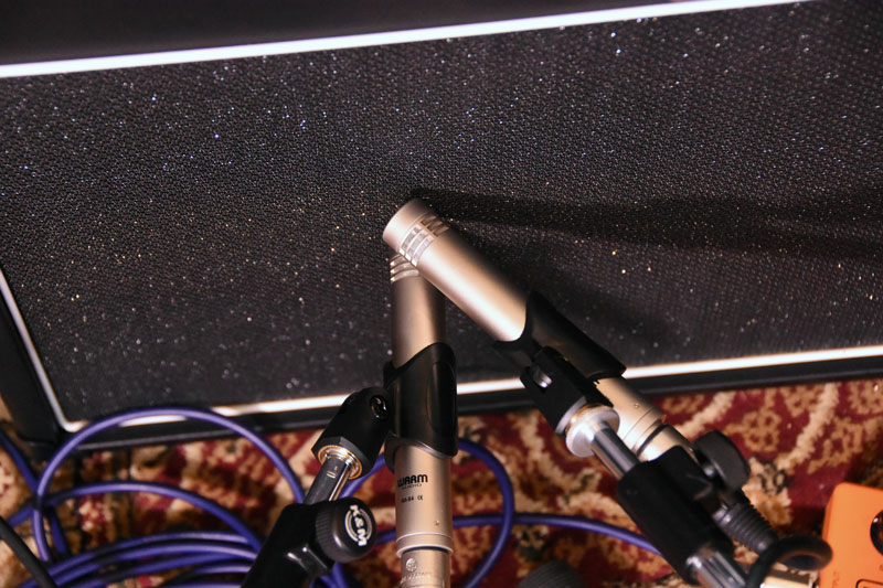 A pair of Warm Audio WA-84 small diaphragm condenser mics on a singe guitar speaker
