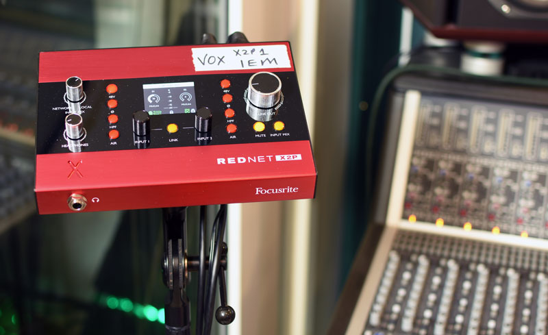 Focusrite Rednet X2P mounted on a mic stand ready for vocal monitoring duties.