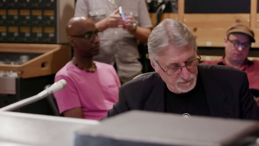 Frank Filipetti, Omar Hakim and the band in the control room listening to a playback