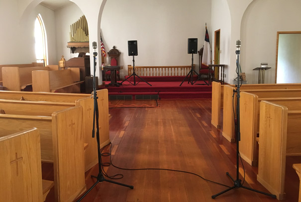 Church Sanctuary with speakers and microphones in place
