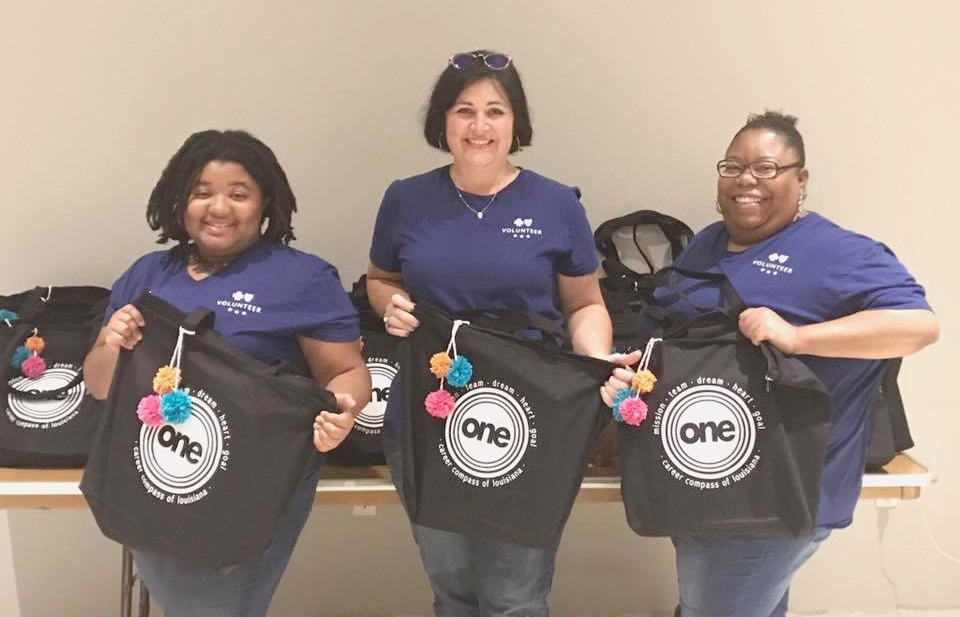 Team Blue volunteers made sure that our annual statewide training for college & career coaches happened without a hitch. Michelle Miller is in the middle.